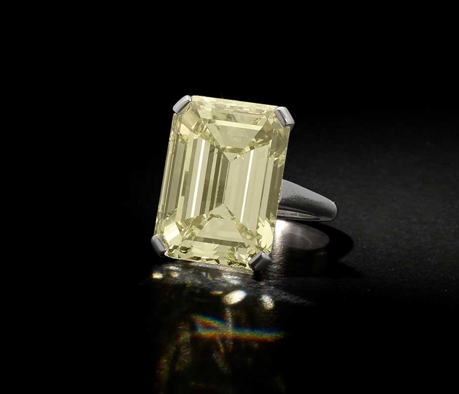 Lot 187, a yellow diamond ring, set with a step-cut Fancy Yellow diamond weighing 24.59ct (estimate: £150,000-£250,000)