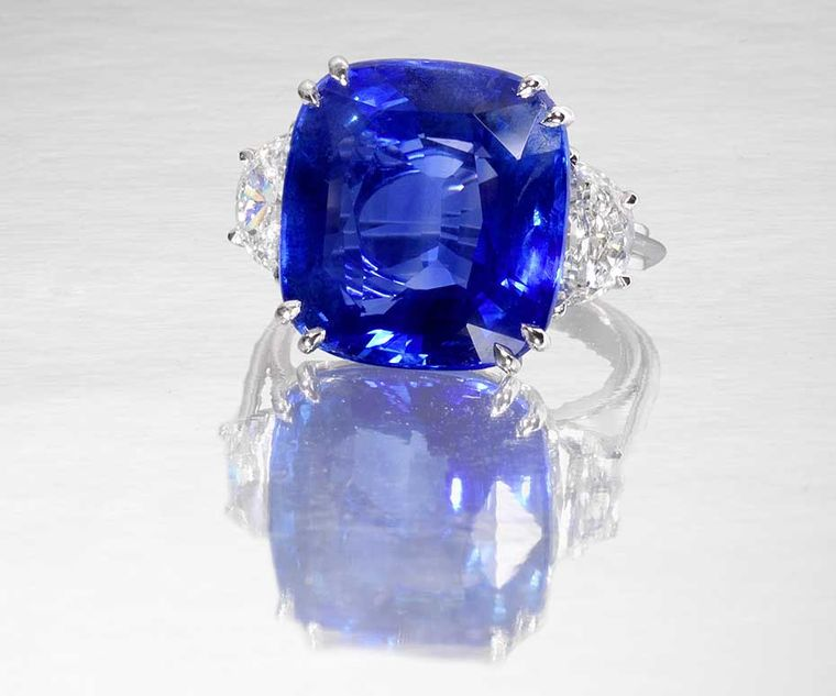 Lot 190, a Burmese sapphire and diamond ring. The cushion-shaped sapphire weighs 22.18ct, flanked on either side by demi lune-shaped diamonds. Sold for £326,500 (estimate: £175,000-200,000)
