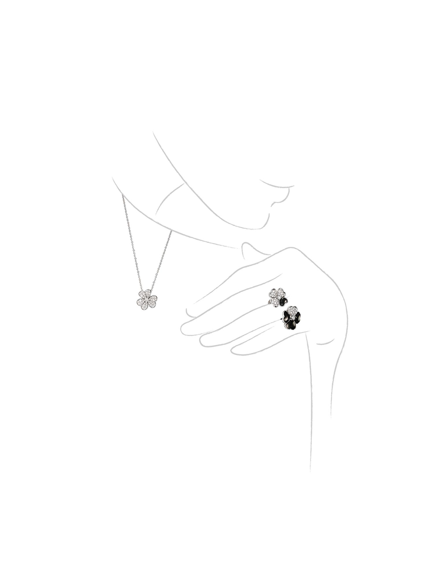Van Cleef & Arpels Cosmos Between the Finger onyx and diamond ring and Cosmos diamond necklace.
