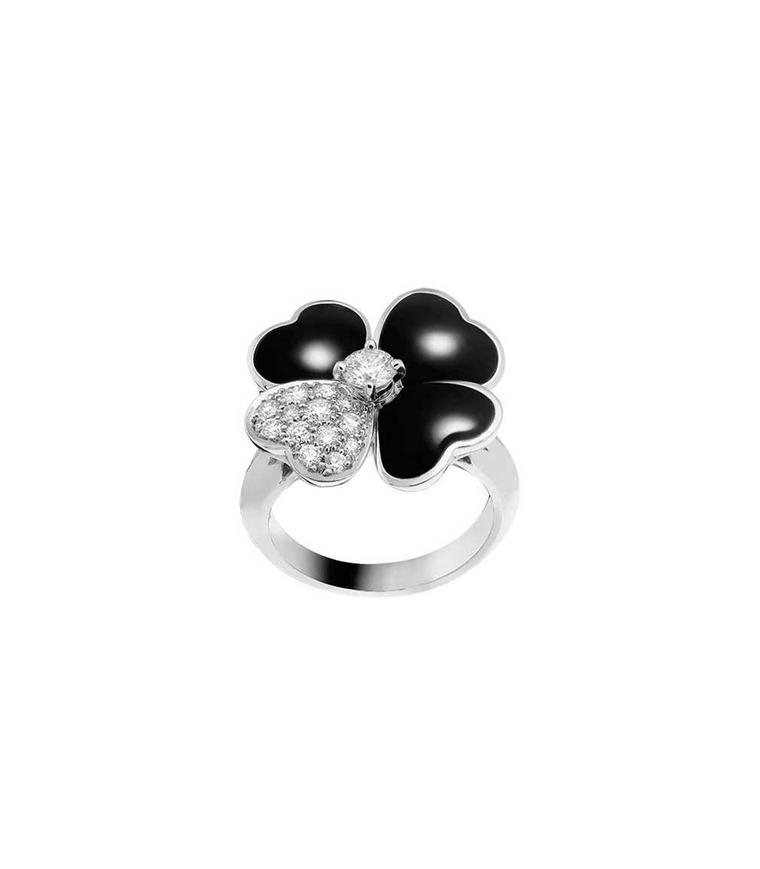 Van Cleef & Arpels Cosmos ring in white gold with a brilliant-cut diamond bud surrounded by onyx and diamond petals