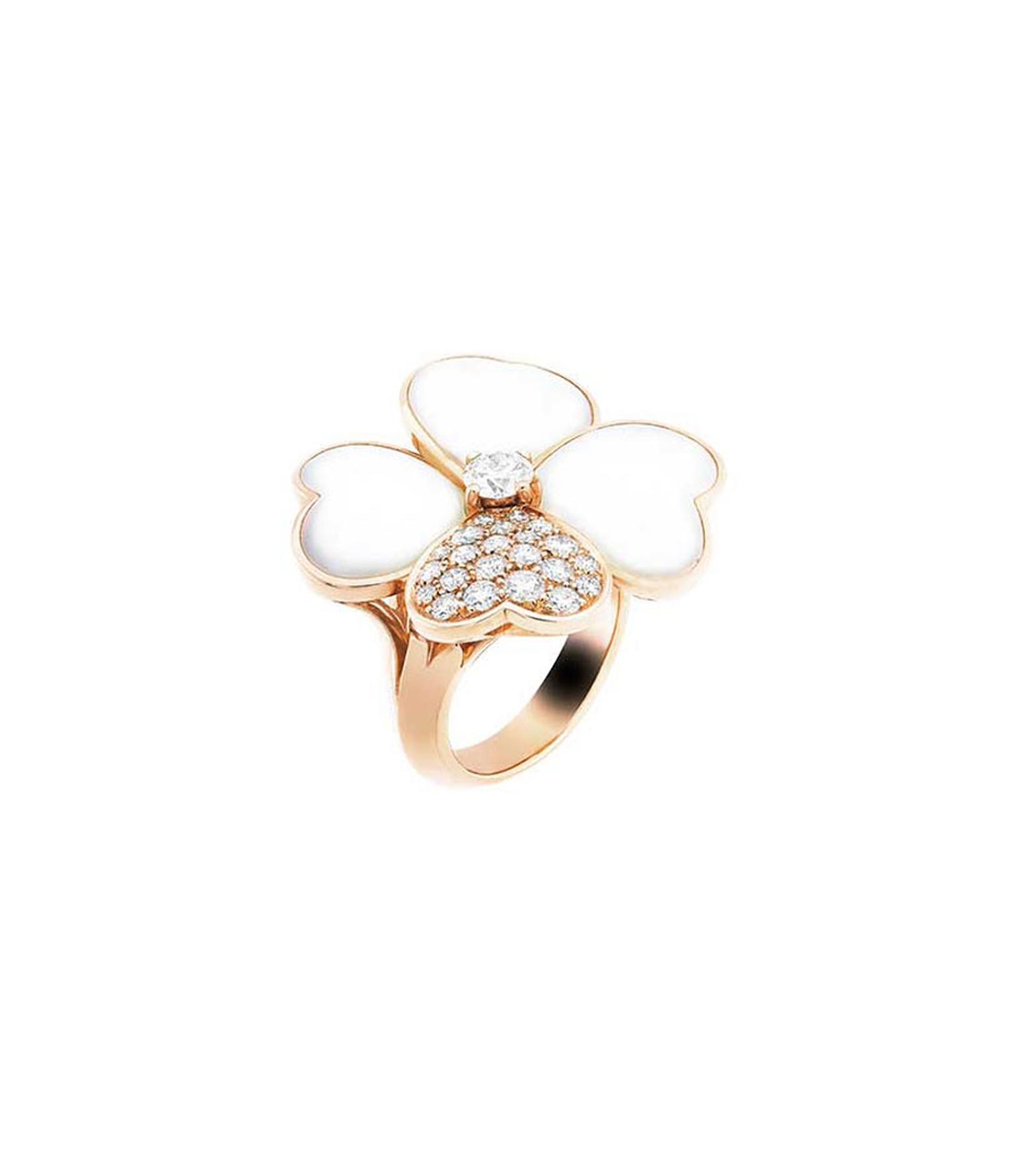 Van Cleef & Arpels Cosmos ring in rose gold with a brilliant-cut diamond bud surrounded by white mother-of-pearl and diamond petals