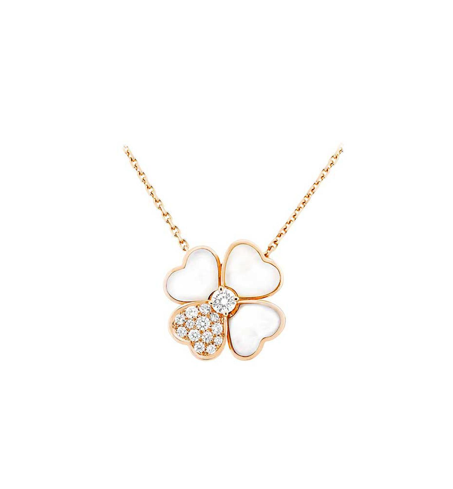 Van Cleef & Arpels Cosmos necklace in rose gold with a brilliant-cut diamond bud surrounded by white mother-of-pearl and diamond petals