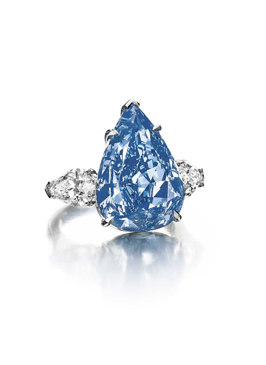 To be sold at the Magnificent Jewels auction to be held in Geneva on 14 May 2014, the Christie's Lot 260 'The Blue' diamond (13.22ct) features two pear-shaped diamond on either side. Images By: Christie's Images Ltd. 2014