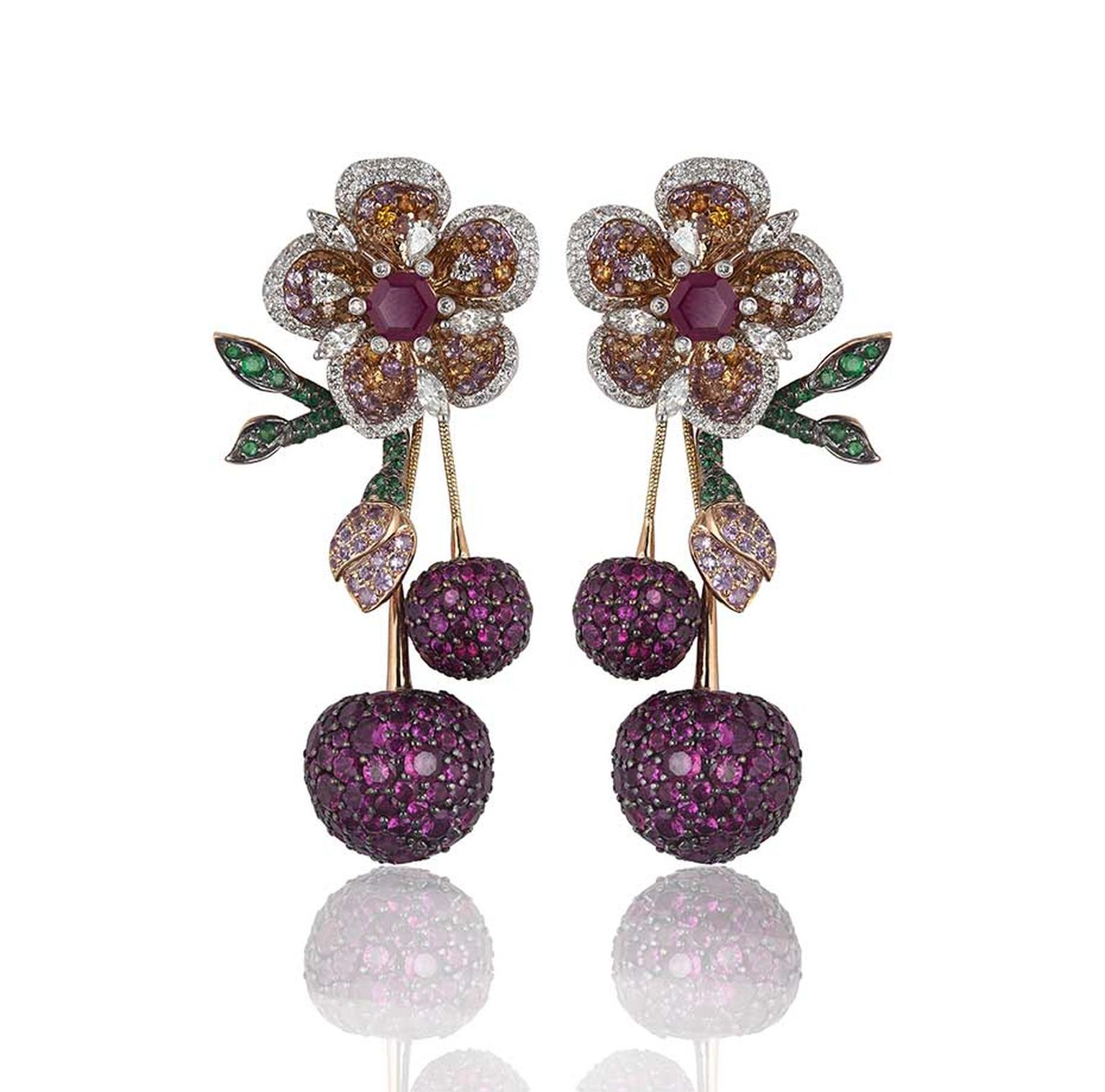Lot 6, a pair of Gemfields Mozambican ruby, Gemfields Zambian emerald, diamond, pink sapphire and orange sapphire earrings by Mirari, being auctioned as part of a suite (estimate: INR 3,600,000 - 4,350,000; $60,000 - 73,000)
