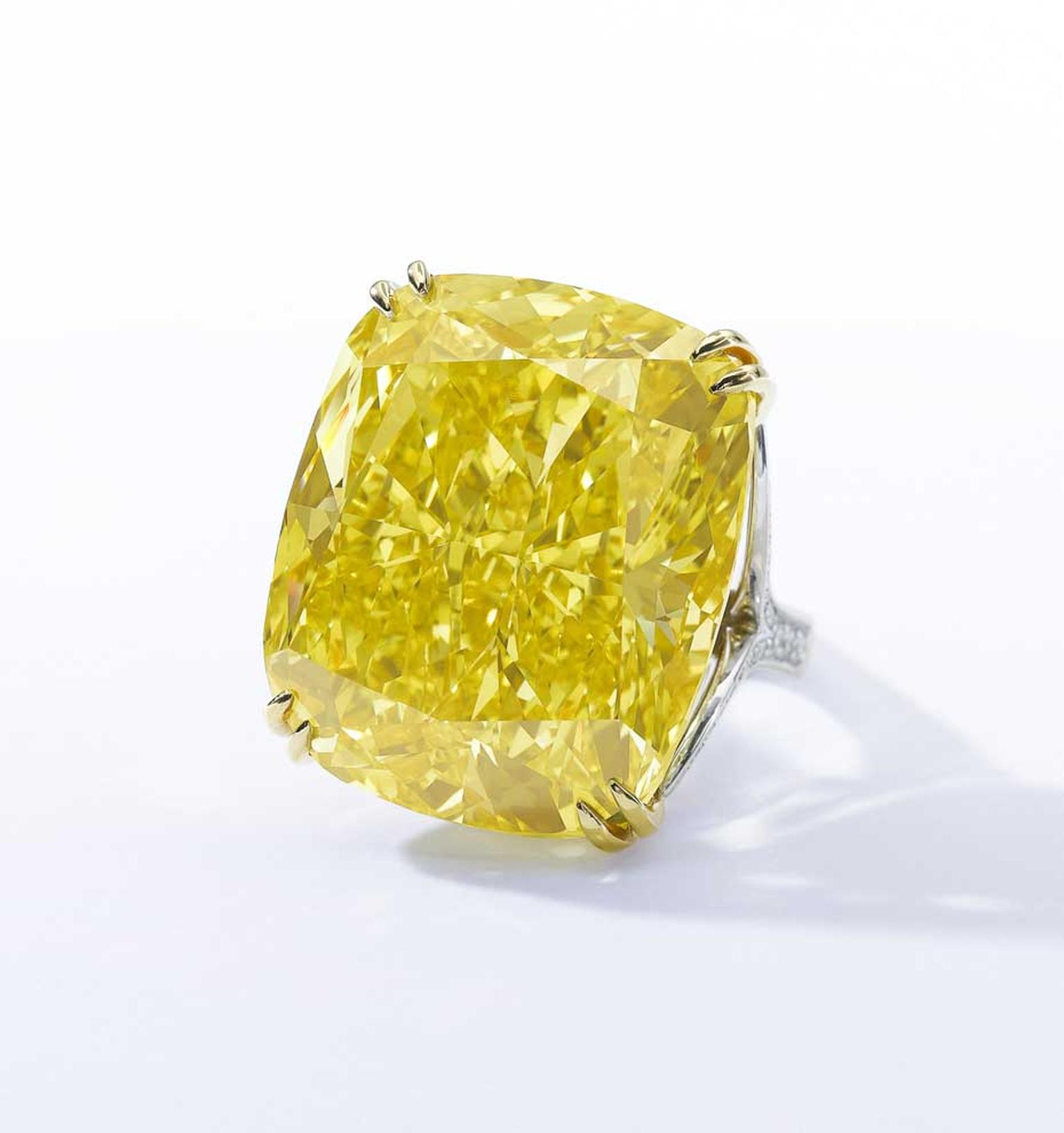 The 100.09 carat Graff Vivid Yellow diamond is one of the largest Fancy Vivid yellow diamonds ever seen. It set a new world auction record for the highest price ever paid for a yellow diamond when it sold for $16.3 million at Sotheby's Geneva on 13 May 20
