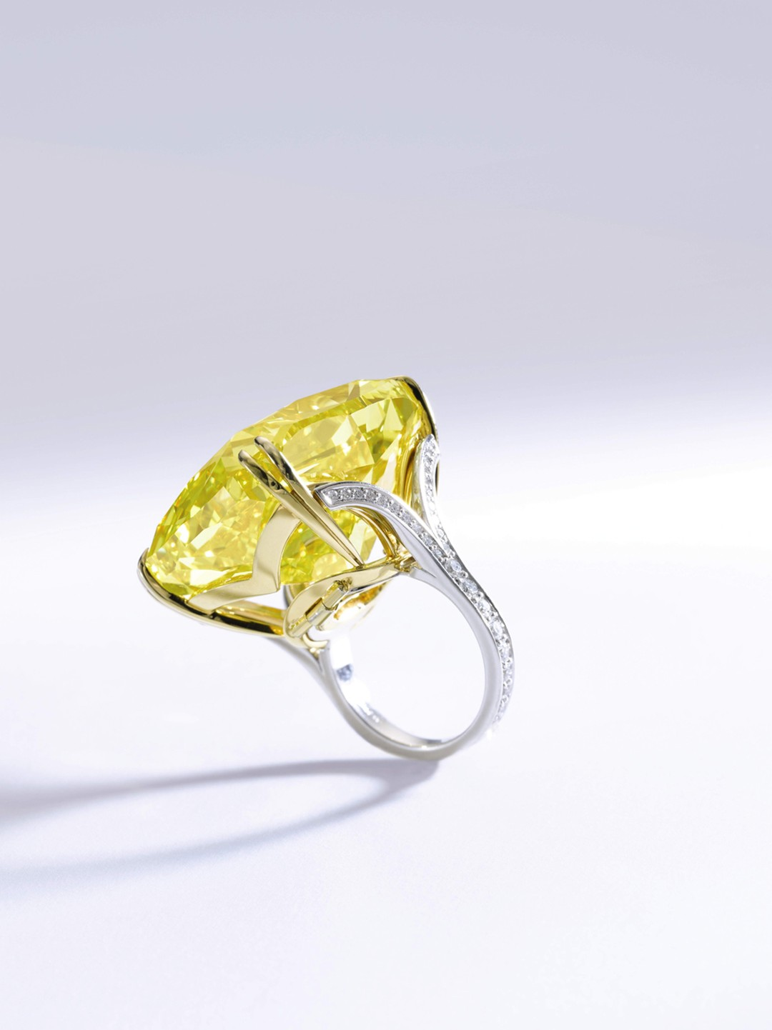 The Graff Vivid Yellow diamond ring features shoulders embellished with brilliant-cut diamonds. Sold for CHF 14.5million (estimate: CHF 13.4- 22.3million)