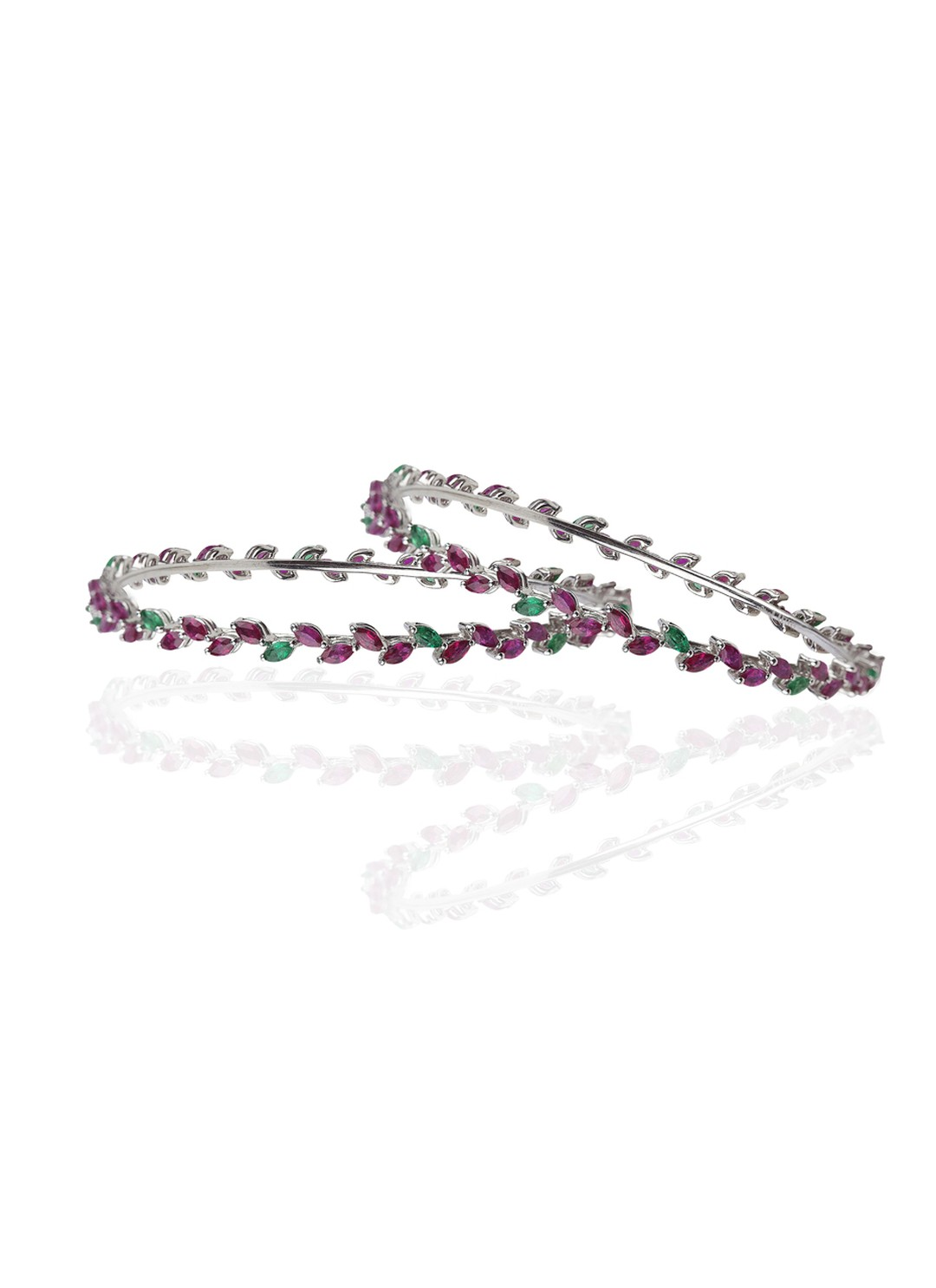 Mirari white gold bangles featuring marquise cut rubies and emeralds.