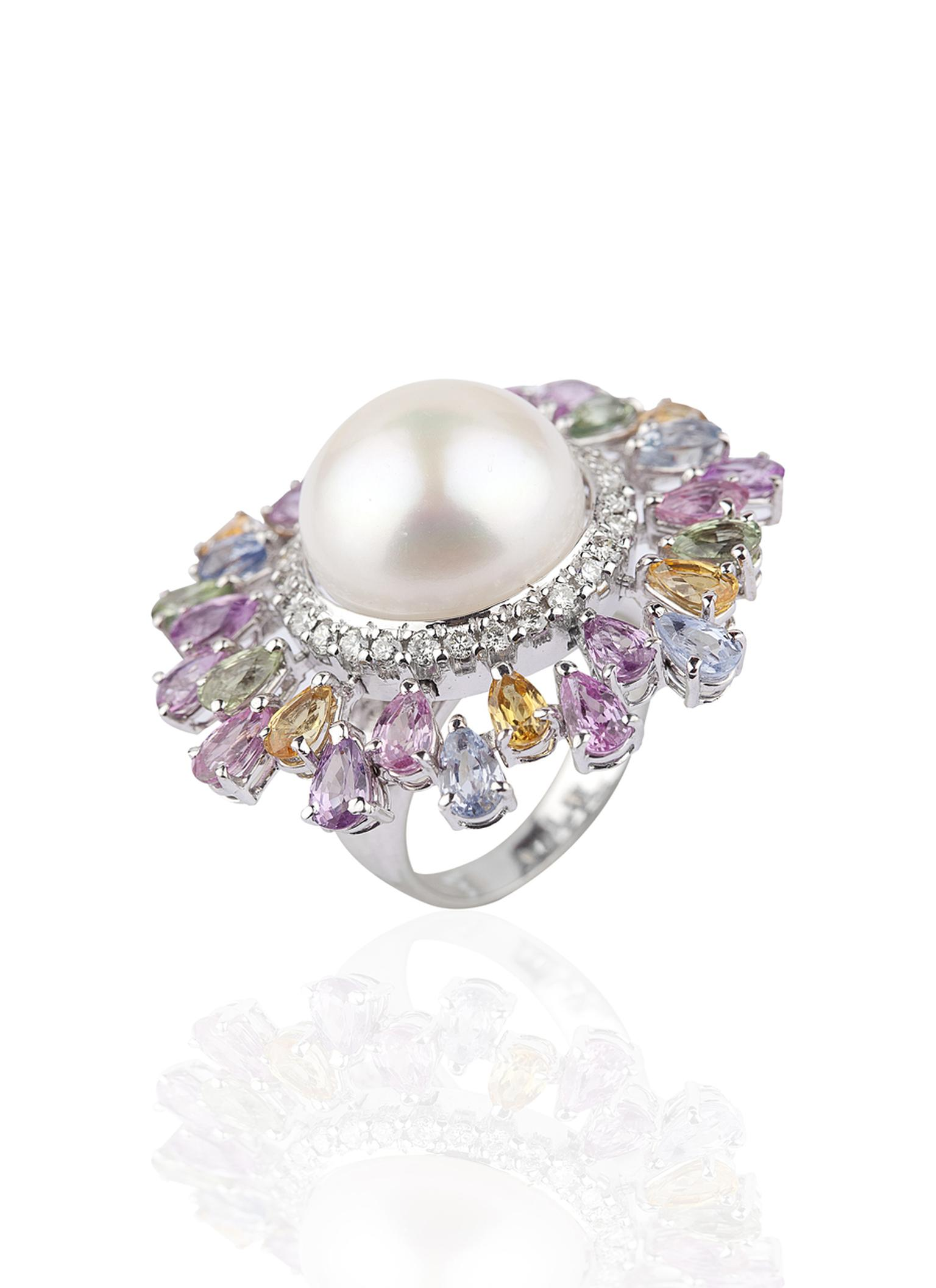 Mirari white gold ring featuring multi-coloured sapphires and round brilliant cut diamonds surrounding a freshwater button pearl.
