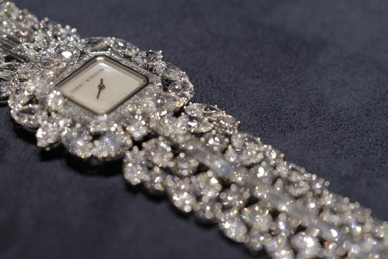 Harry Winston Emerald Cluster watch, set with 73ct of emerald-cut diamonds