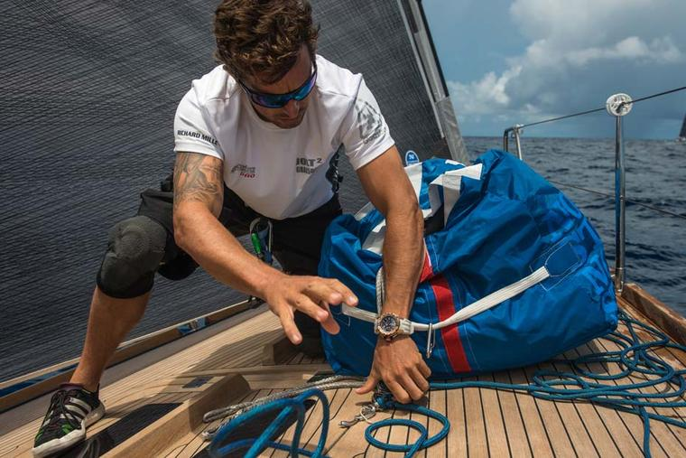 Bowman and captain Adam Davis checks timings on his RM 032 automatic chronograph