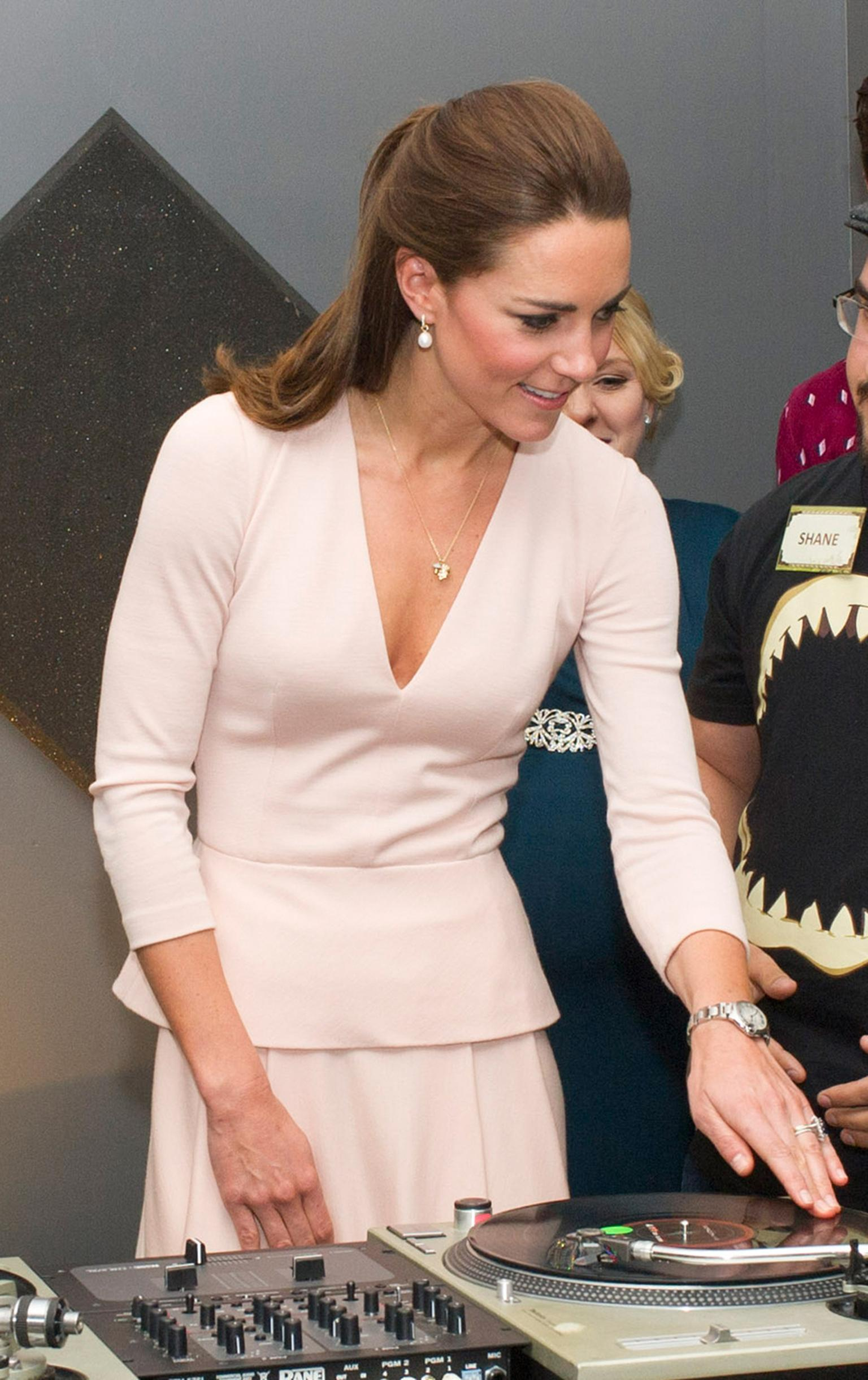 Kate Middleton staying true to her British roots in an Asprey charm necklace and Annoushka pearl earrings during the Royal Tour