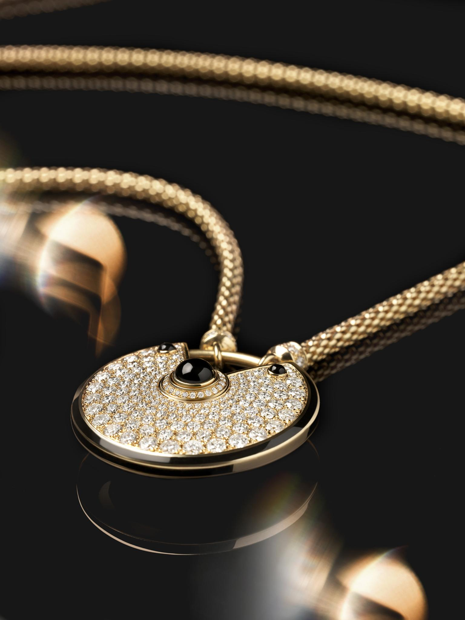 Amulette de Cartier large gold and black lacquer pendant with diamonds and three onyx cabochons