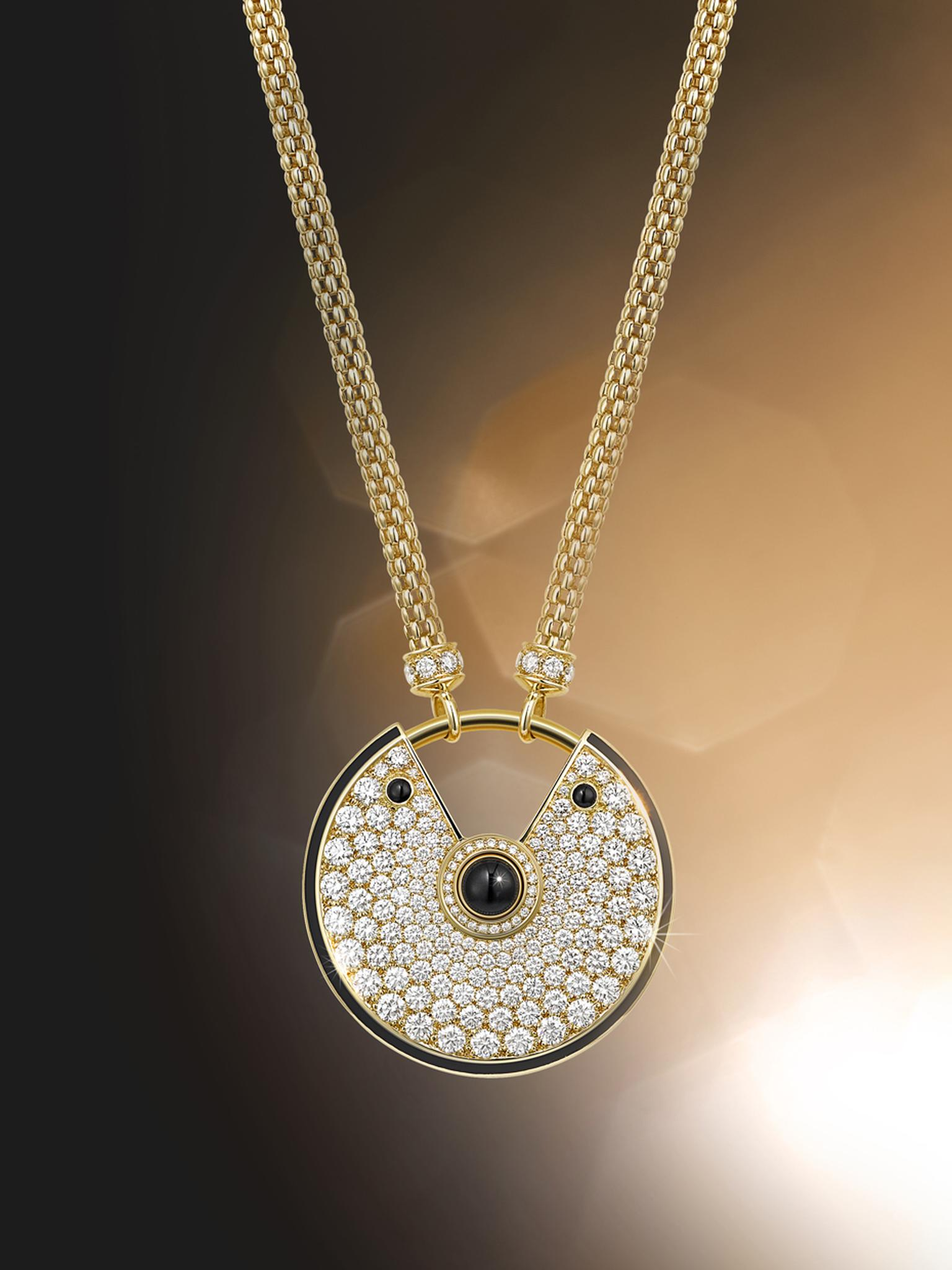 Amulette de Cartier large gold and black lacquer pendant with diamonds and three onyx cabochons.