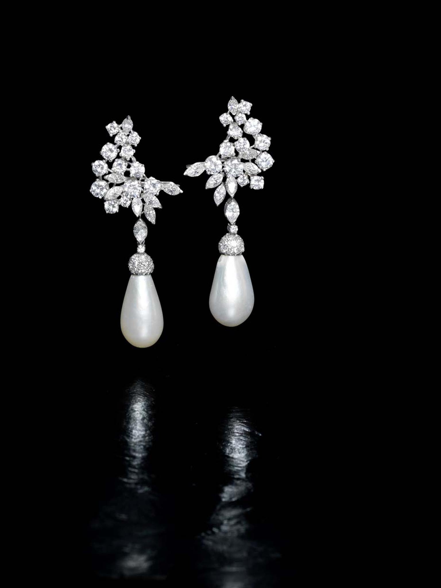 Lot 188, a pair of natural pearl and diamond (6ct) pendant earrings. Sold for £290,500 (estimate: £150,000-200,000)