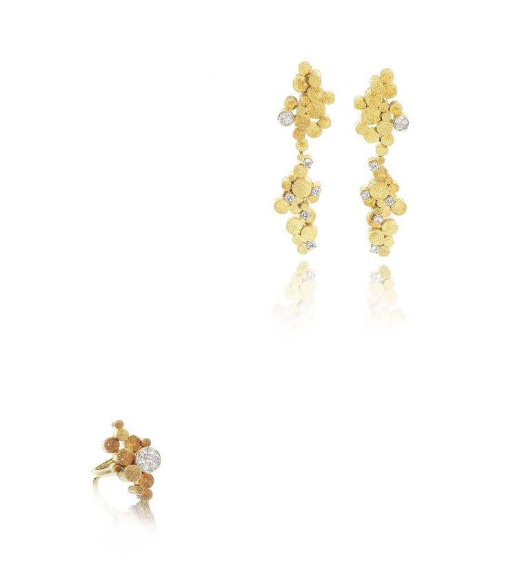 Lot 95, Andrew Grima gold and diamond Night and Day earrings and ring suite. Sold for £15,000 (estimate: £3,000-4,000)