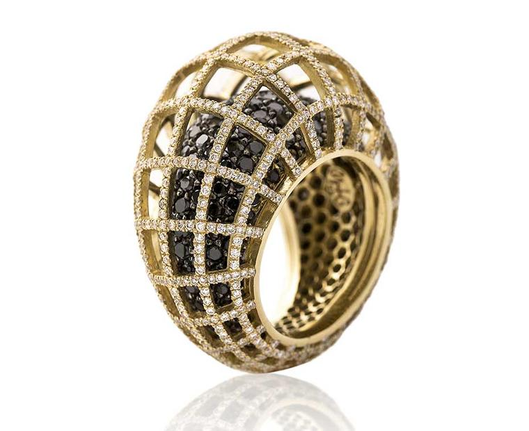 I am looking forward to trying on Nada G's three-dimensional Matrix Double ring in yellow gold with black and white diamonds at the Couture Show Las Vegas