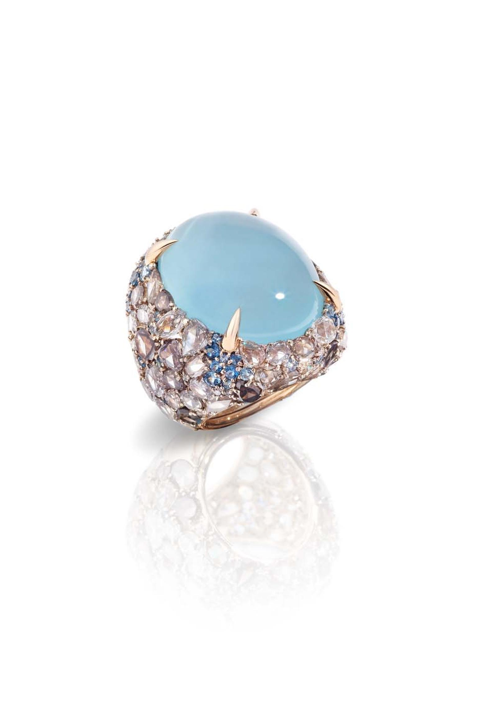Pomellato Pom Pom collection ring featuring a light-blue cabochon surrounded by aquamarines and a pavé of brown diamonds.
