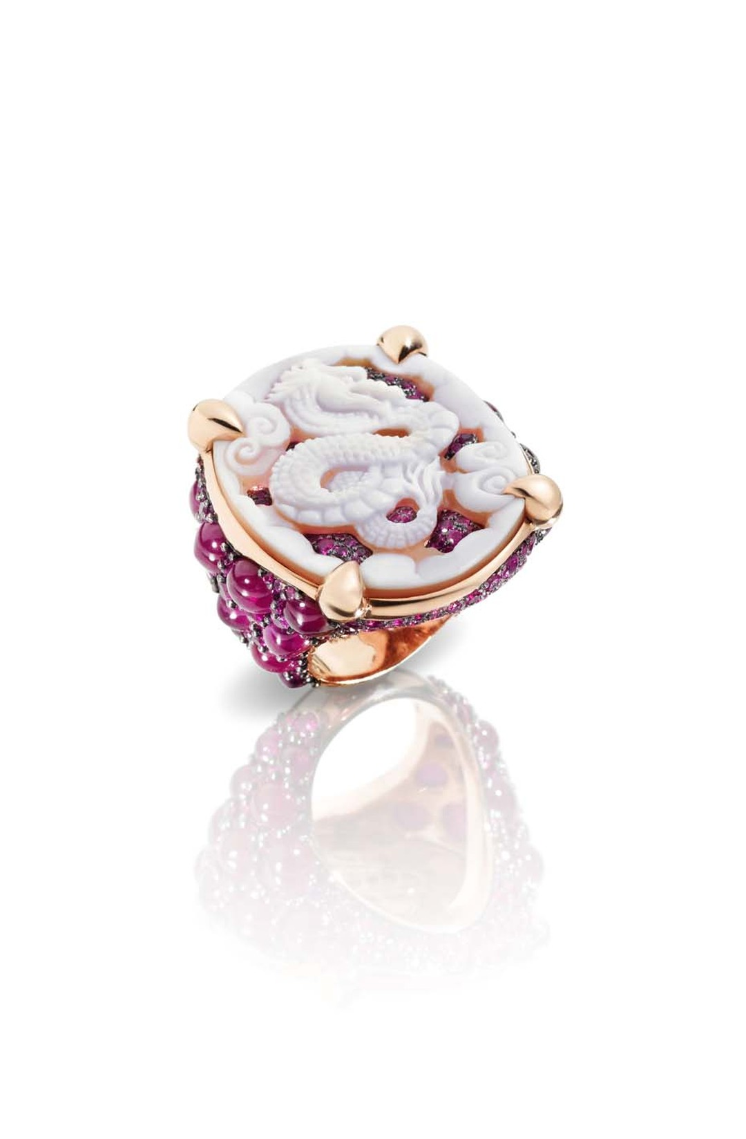 Pomellato Pom Pom Dragon ring in rose gold featuring a band covered with cabochon-cut rubies.