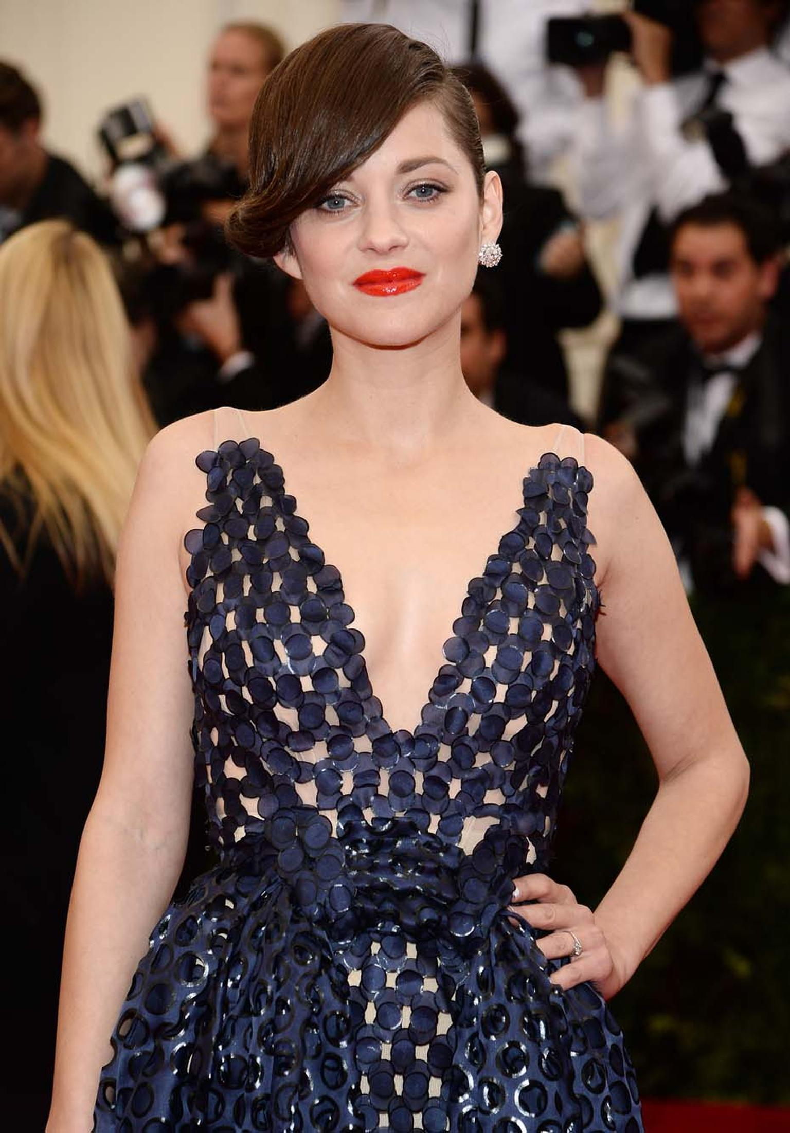 Oscar winner Marion Cotillard channelled the trend for just one earring - a platinum and diamond cluster from Chopard's platinum collection.
