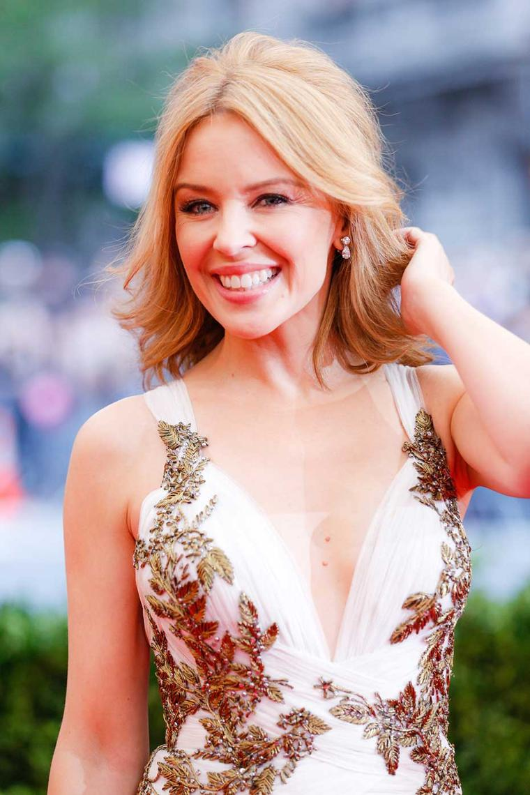 Kylie Minogue embraced the 'White tie and decorations' dress code at the Met Ball 2014 in a beaded Marchesa gown paired with Daytime Diamond Drop earrings paired with a Princess-cut diamond bracelet by Harry Winston