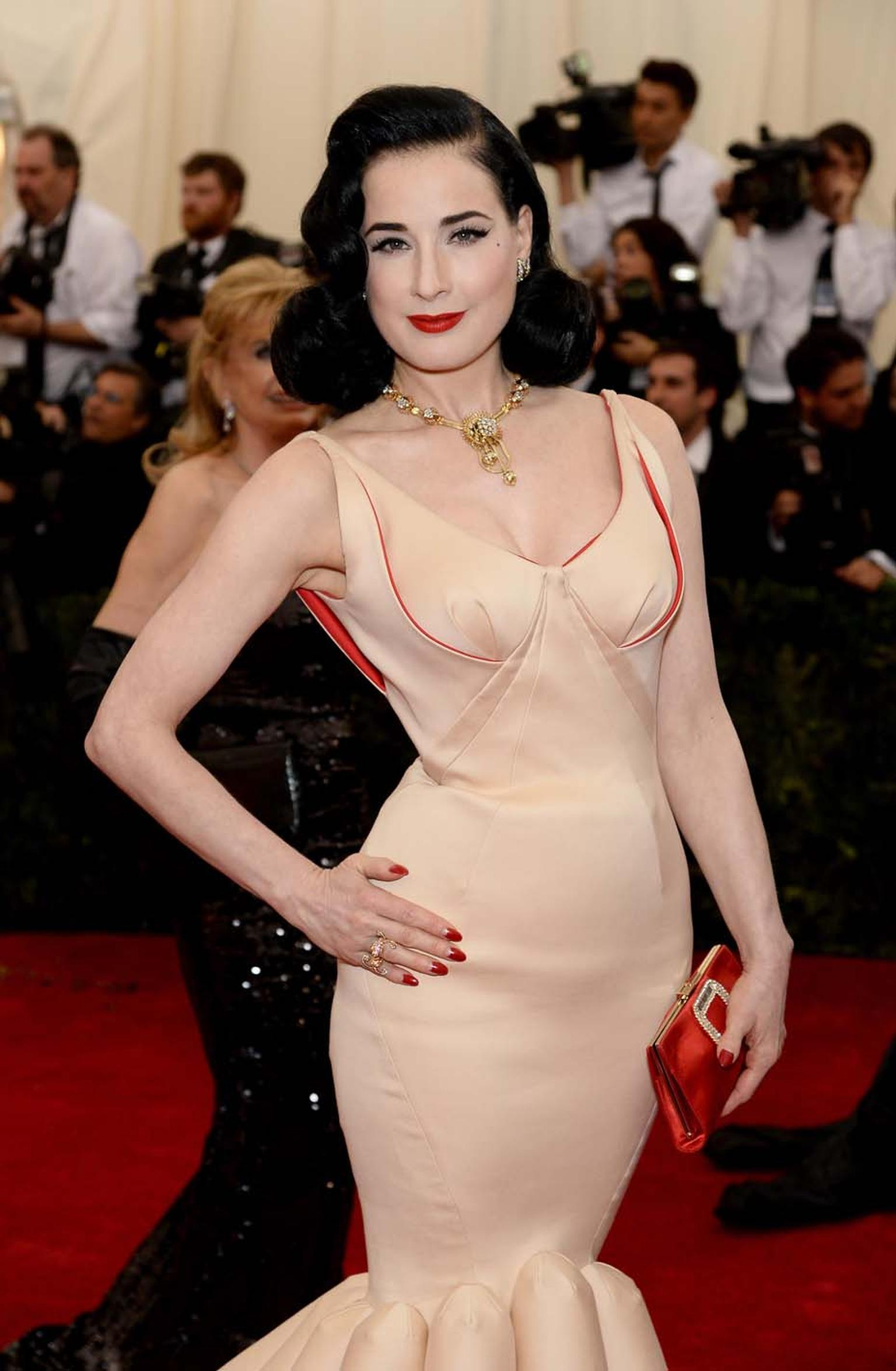 "Dita von Teese channeled her trademark vintage vibe in a figure-hugging Zac Posen frock accessorised with an ""Estate"" necklace dating back to 1946, ""Three Leaves"" Estate diamond earrings and an ""Oiseaux de Paradis"" Between the Finger ring, all by Van Clee"