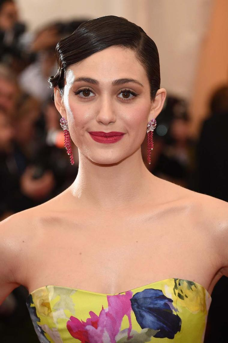 "Actress Emmy Rossum teamed an eye-catching floral Carolina Herrera gown with Van Cleef & Arpels ""Oiseaux Flamboyant"" earrings from the Birds of Paradise collection with red spinels, pink sapphires and diamonds"