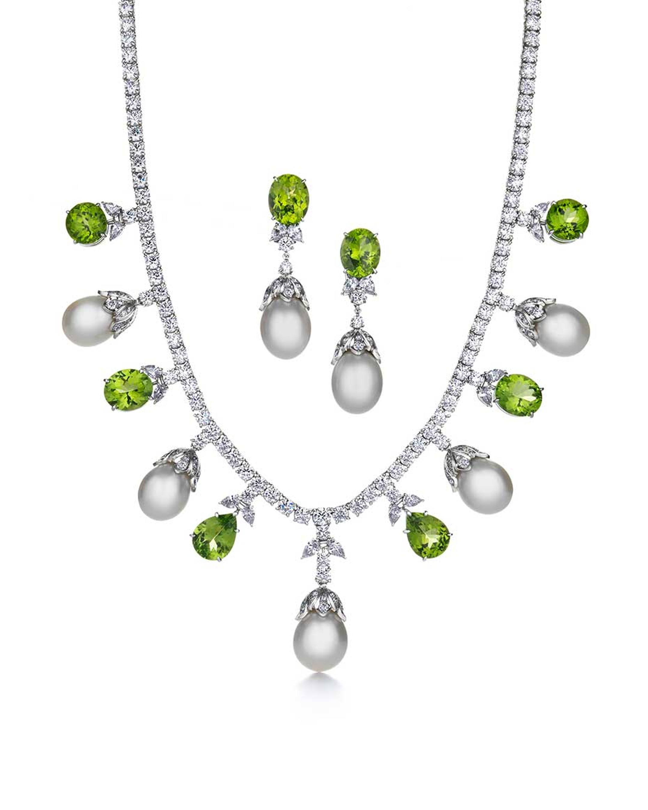 Tiffany & Co. Triple Strand platinum necklace and earrings featuring white South Sea pearls, bright green peridots and diamonds
