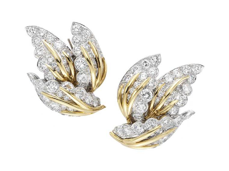 Worn by Dita von Teese to the 2014 Met Ball, the Van Cleef & Arpels Three Leaves Estate earrings featuring diamonds set in platinum, white and yellow gold.