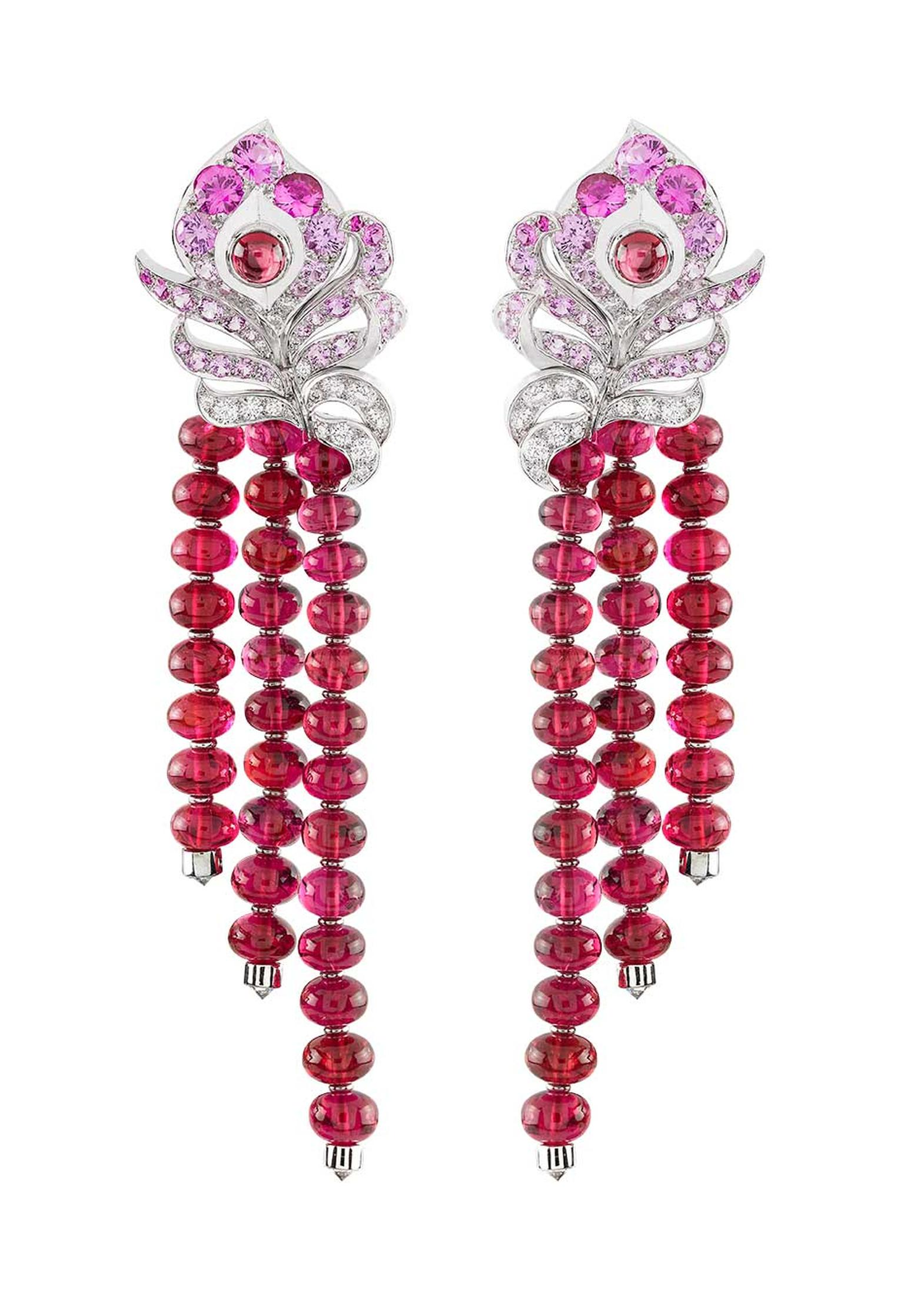 Worn by Emmy Rossum to the 2014 Met Ball, the Van Cleef & Arpels Oiseaux Flamboyant earrings from the 'Birds of Paradise' collection featuring red spinels, pink sapphires and diamonds