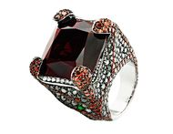 Crow's Nest Deluxe Russian Grooves white gold ring in black rhodium with white diamonds and black diamonds, accompanied by a red garnet - one of many impressive pieces that this Russian jeweller will be showcasing at the Couture Show Las Vegas