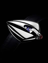 With cambered curves in polished titanium and geometry reminiscent of Art Deco design, the functions of the De Bethune Dream Watch 5 - hours, minutes and Moon phase - are secondary to the sculptural dimension of this 'spaceship' for the wrist