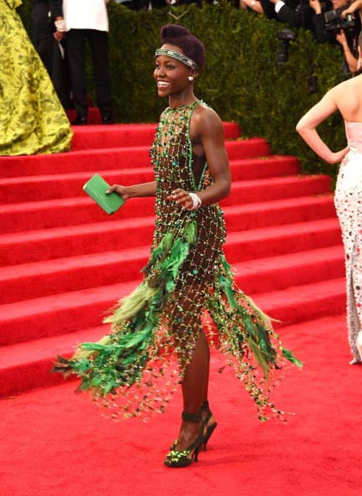 Lupita Nyong'o wore the most flamboyant outfit of the night courtesy of Prada and didn't hold back on her jewels either. She wore a vintage 1906 diamond headpiece, two vintage diamond bracelets, a parrot ring, diamond earrings and an emerald and diamond b
