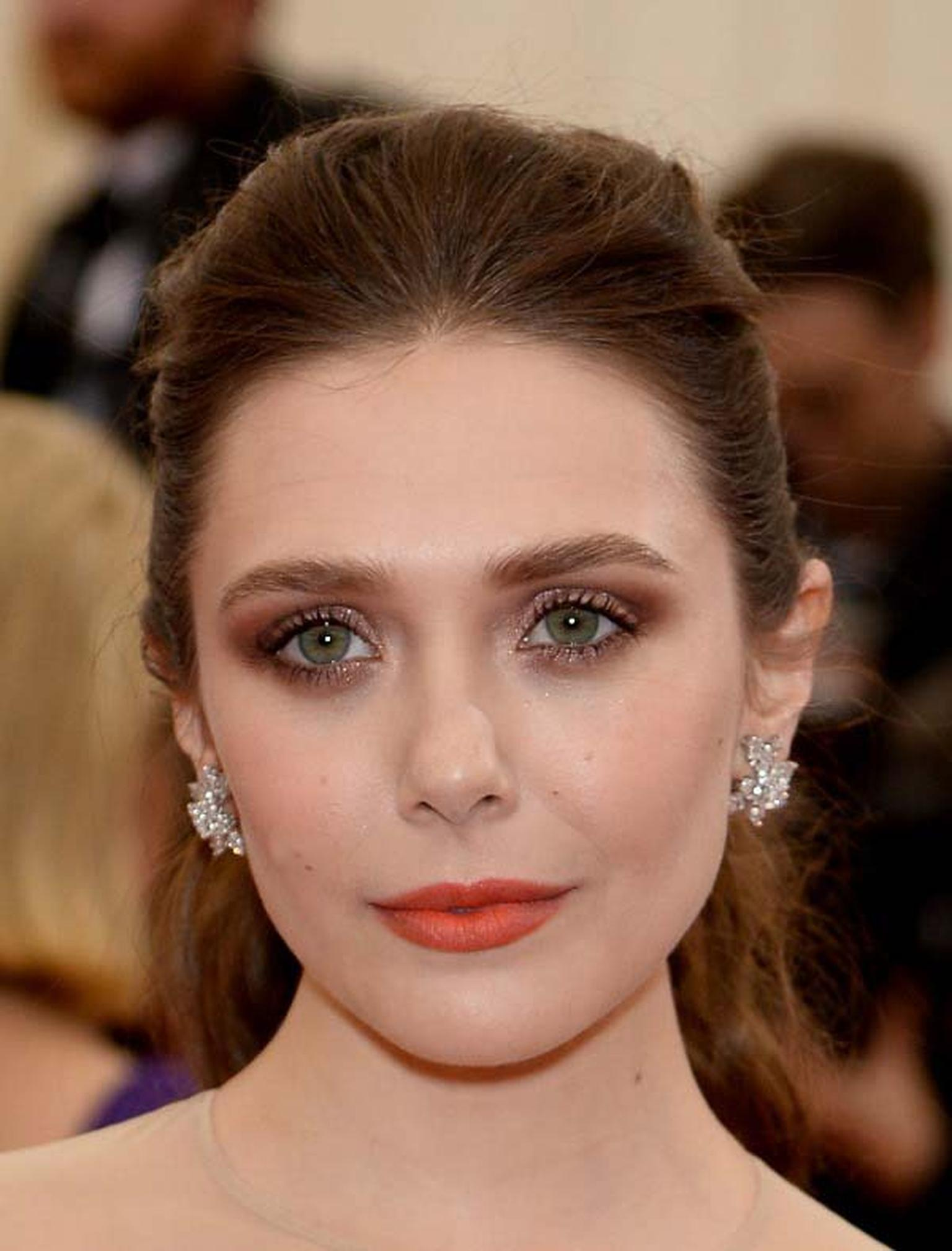 Elizabeth Olsen looked flawless in classic Cartier diamond cluster earrings