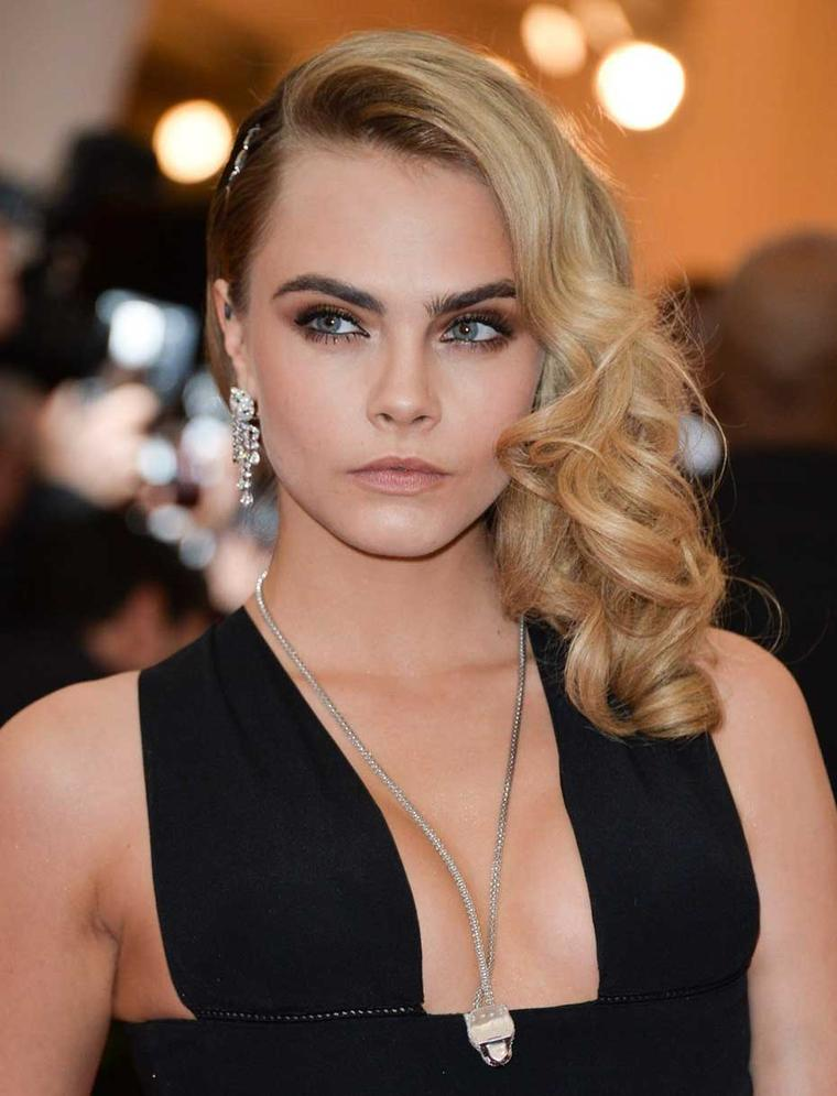 Cara Delevingne wore some of the most impressive jewels of the night, all from Cartier, including a Panthère de Cartier necklace, Panthère earrings and a diamond necklace holding her side-swept hair in place