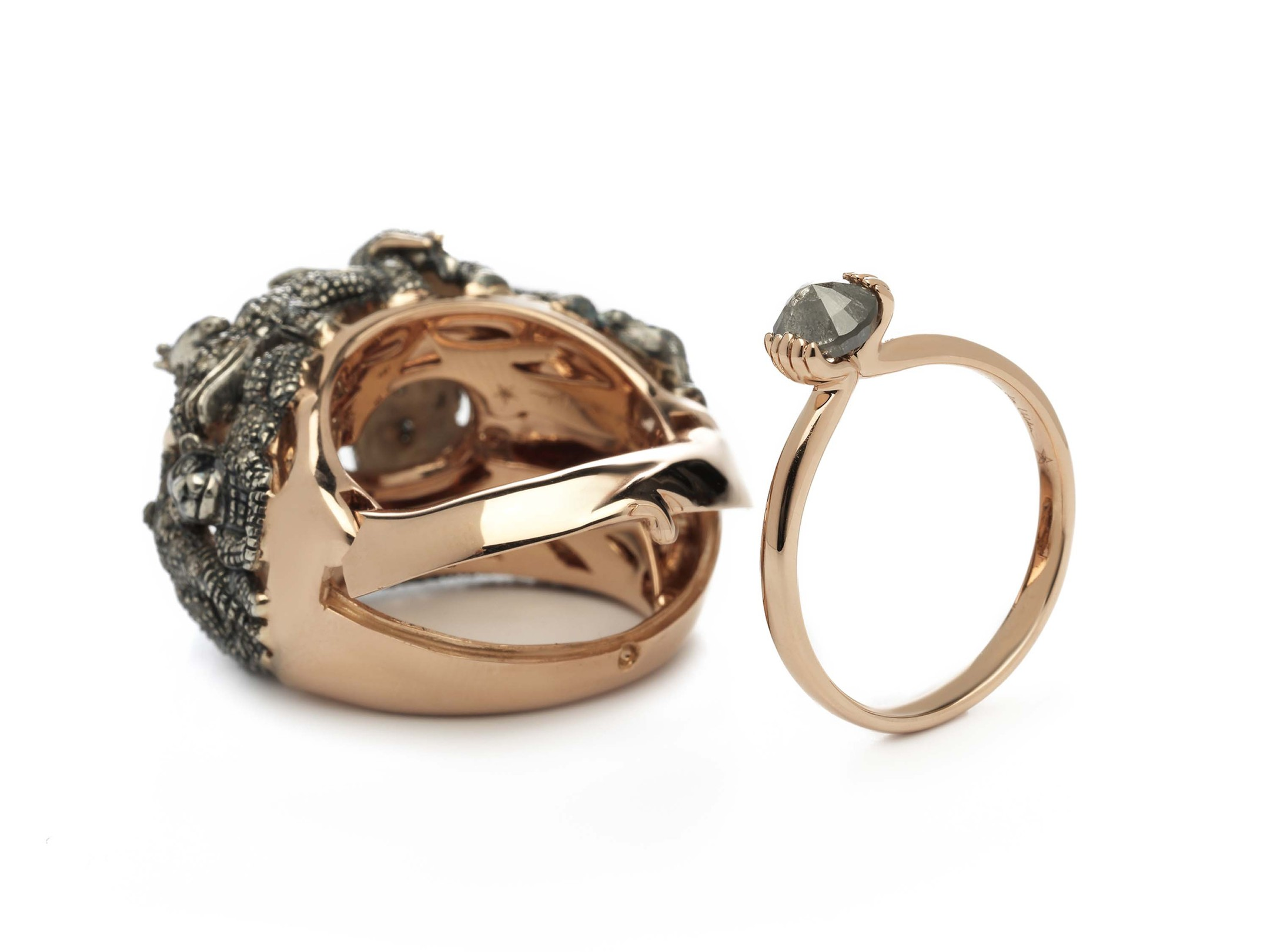 "Bibi van der Velden's ""ring within a ring"", which will be shown for the first time at The Couture Show 2014. The main ring is decorated with miniature elephants, giraffes, lions and rhinos, while the hidden ring depicts hands clasping a brown diamond"