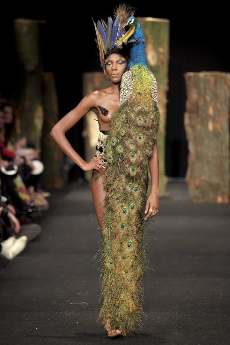 Blurring the line between sculpture and jewellery, Bibi van der Velden has put on catwalk shows highlighting her more avant-garde creations, including this stuffed peacock, which drapes over the body like the most regal jewel
