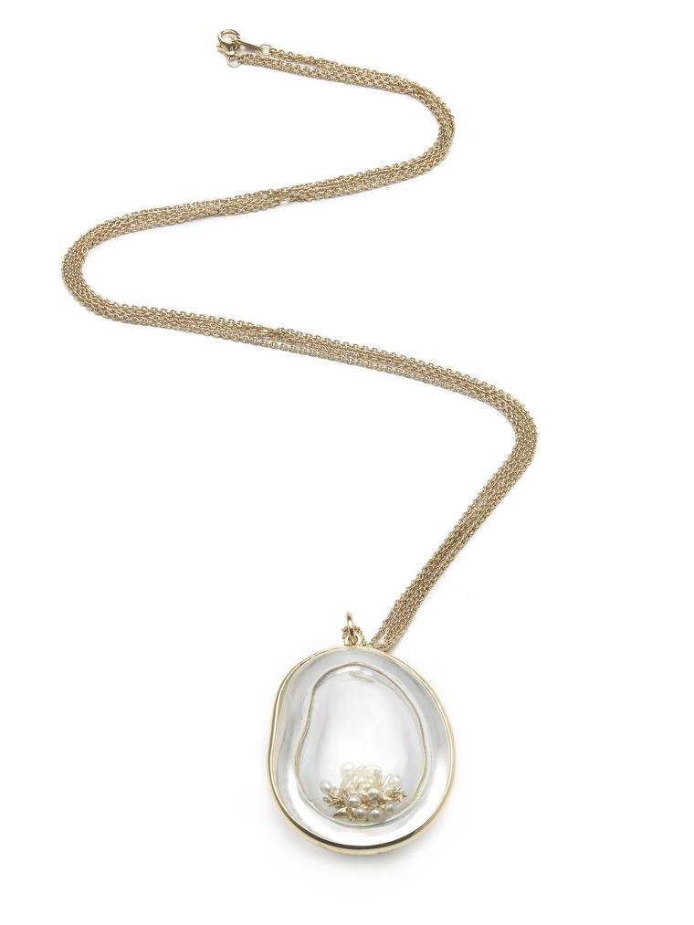 Bibi van der Velden Memorabilia necklace with a hollow bean, carved out of rock crystal, filled with pearls, gold stars and diamonds (€5,495)