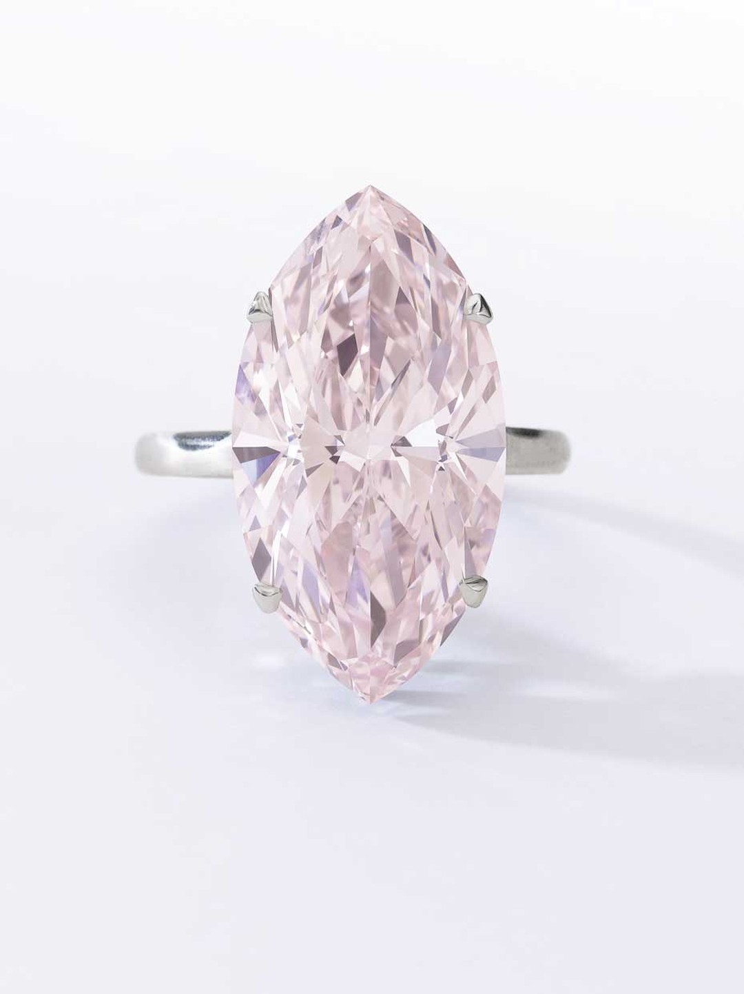 Very Fine Fancy Pink diamond ring featuring a 12.07ct marquise-cut pink diamond. Sold for CHF 6,437,000 (estimate: CHF 3,570,000-6,200,000)