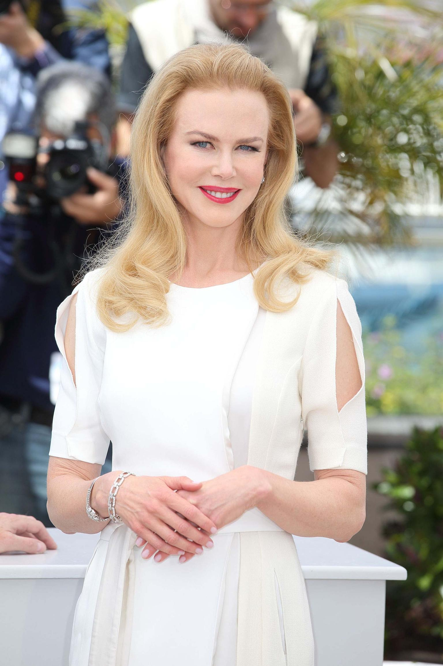 Earlier in the day, at the 'Grace of Monaco' photo call, Nicole Kidman paired her demure white dress with peek-a-boo sleeves with a Harry Winston Diamond Links bracelet and diamond earrings