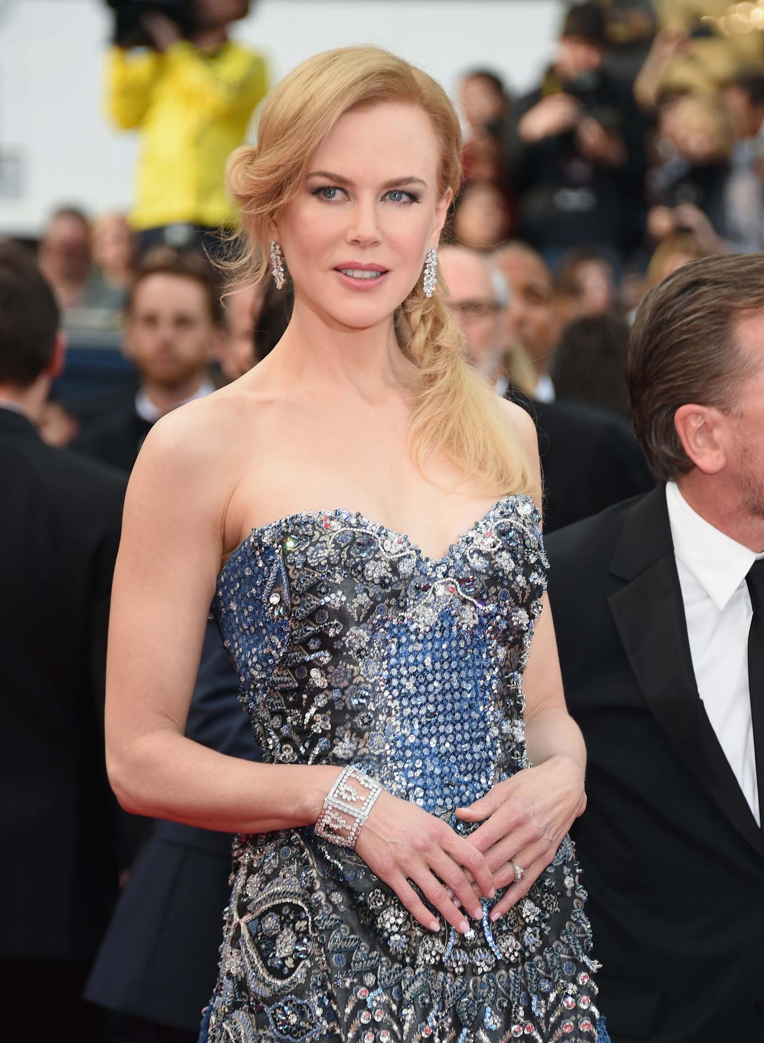 For the opening ceremony and premiere of 'Grace of Monaco' on the first day of the Cannes Film Festival 2014, Nicole Kidman chose a Harry Winston Caftan diamond bracelet and Winston Cluster Diamond Line earrings to complement her heavily embellished Arman