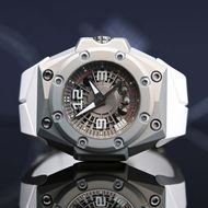 The lightest Linde Werdelin timepiece ever made, the Oktopus MoonLite watch features colourless ALW, an alloy developed by Linde Werdelin that is twice as hard as steel and half the weight of titanium