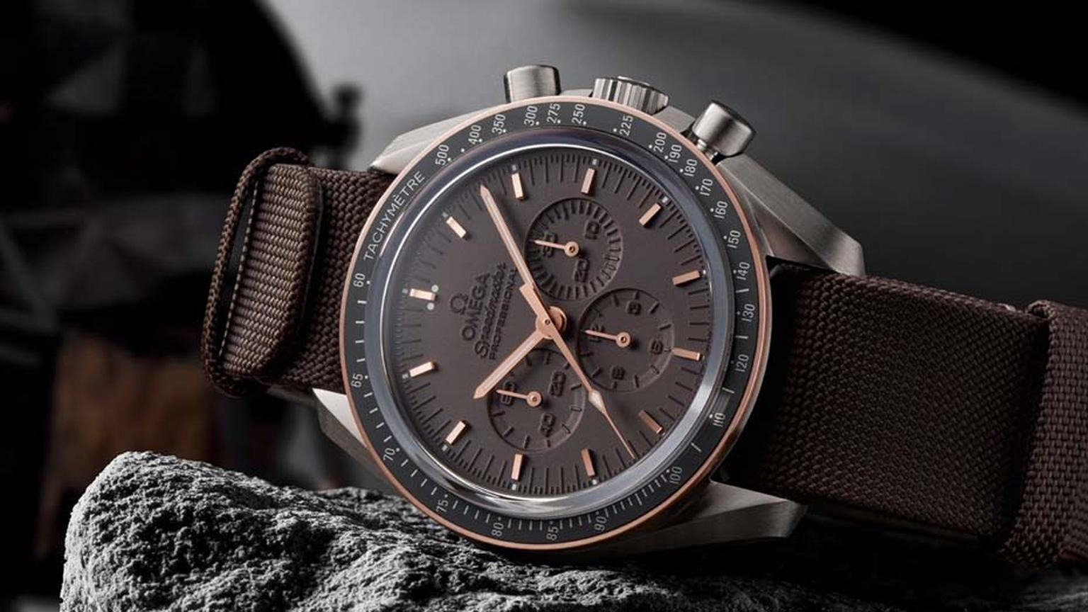 The new Omega Speedmaster Apollo 11 45th Anniversary watch features a dark-grey grade-2 titanium case, Sedna rose gold tachymeter bezel, laser-treated brown dial and a high-quality brown NATO strap