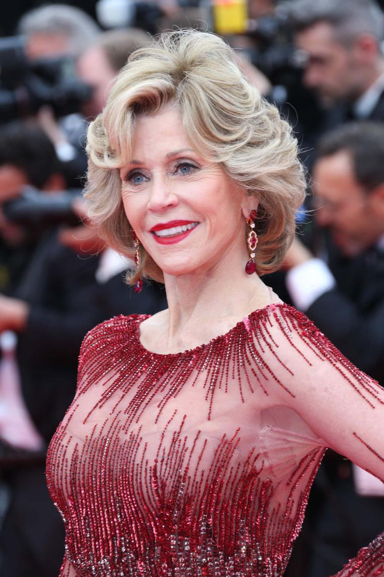 Jane Fonda ramped up the glamour on the Cannes red carpet in an all-red ensemble, including rubellite drop earrings from Chopard's Temptations collection.