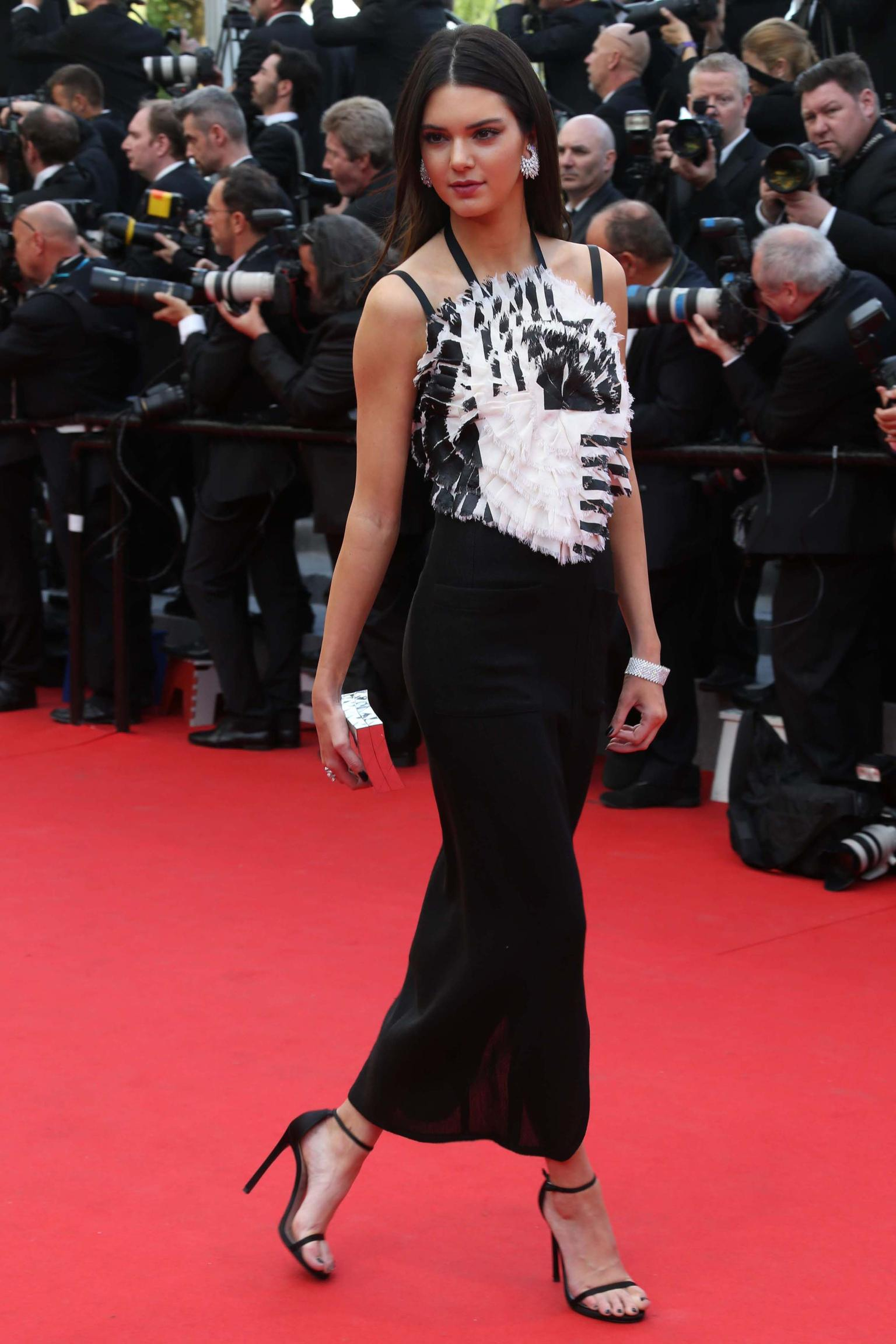 Monochrome dresses dominated the red carpet on day one of the Cannes Film Festival. Model Kendall Jenner paired hers with marquise-cut white diamond cluster earrings, a white diamond cuff and diamond rings, all by Chopard