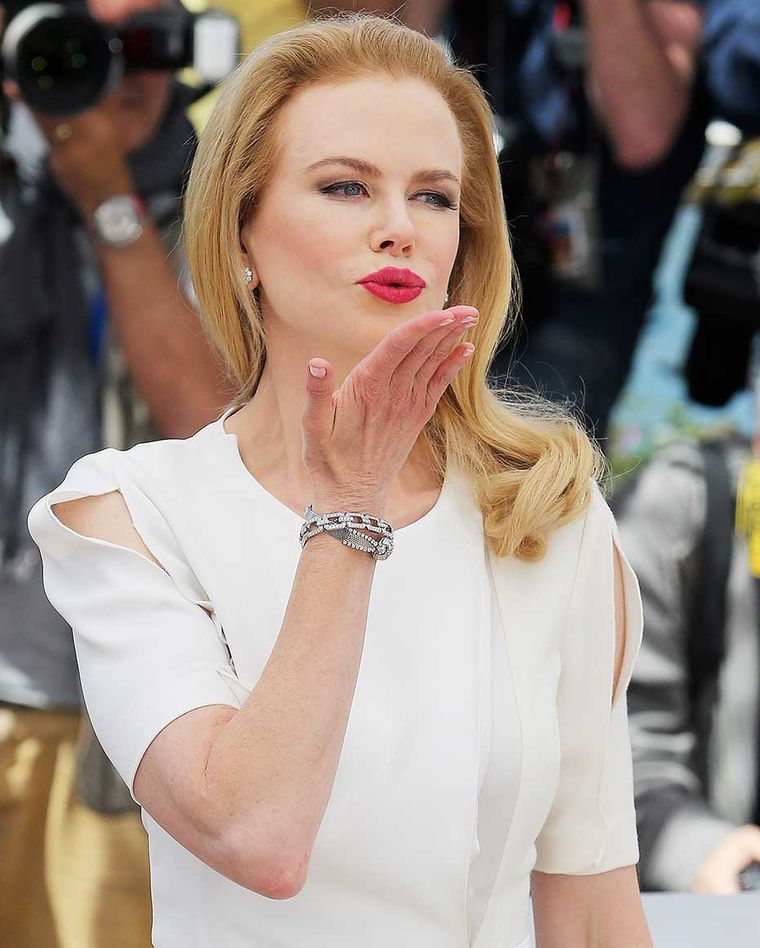 "Earlier in the day, at the 'Grace of Monaco' photo call, Nicole Kidman paired her demure white dress with a Harry Winston Diamond Links bracelet and diamond earrings and a vintage diamond-pavéd Omega ""secret watch"" dating from 1955"