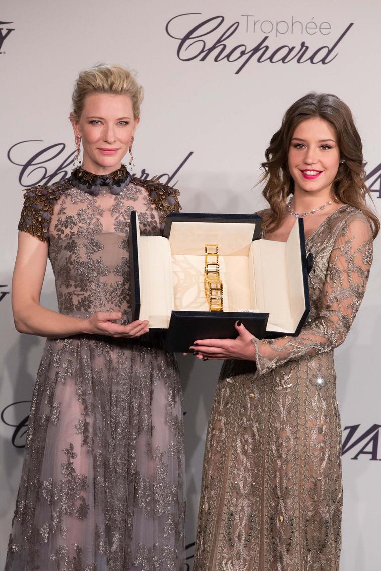 Cate Blanchett, patroness of the Trophée Chopard 2014, presents Adèle Exarchopoulos with her respective prize wearing one-of-a-kind shrimp earrings and a snail bracelet from Chopard's Animal World collection