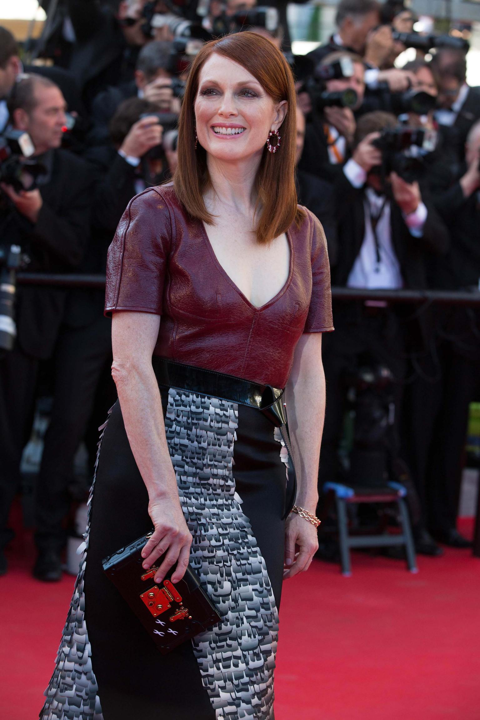 For the premiere of 'Mr Turner' at the 67th Cannes Film Festival, Julianne Moore paired her custom-designed Louis Vuitton with ruby and diamond wreath earrings and two rose gold chain bracelets by Chopard