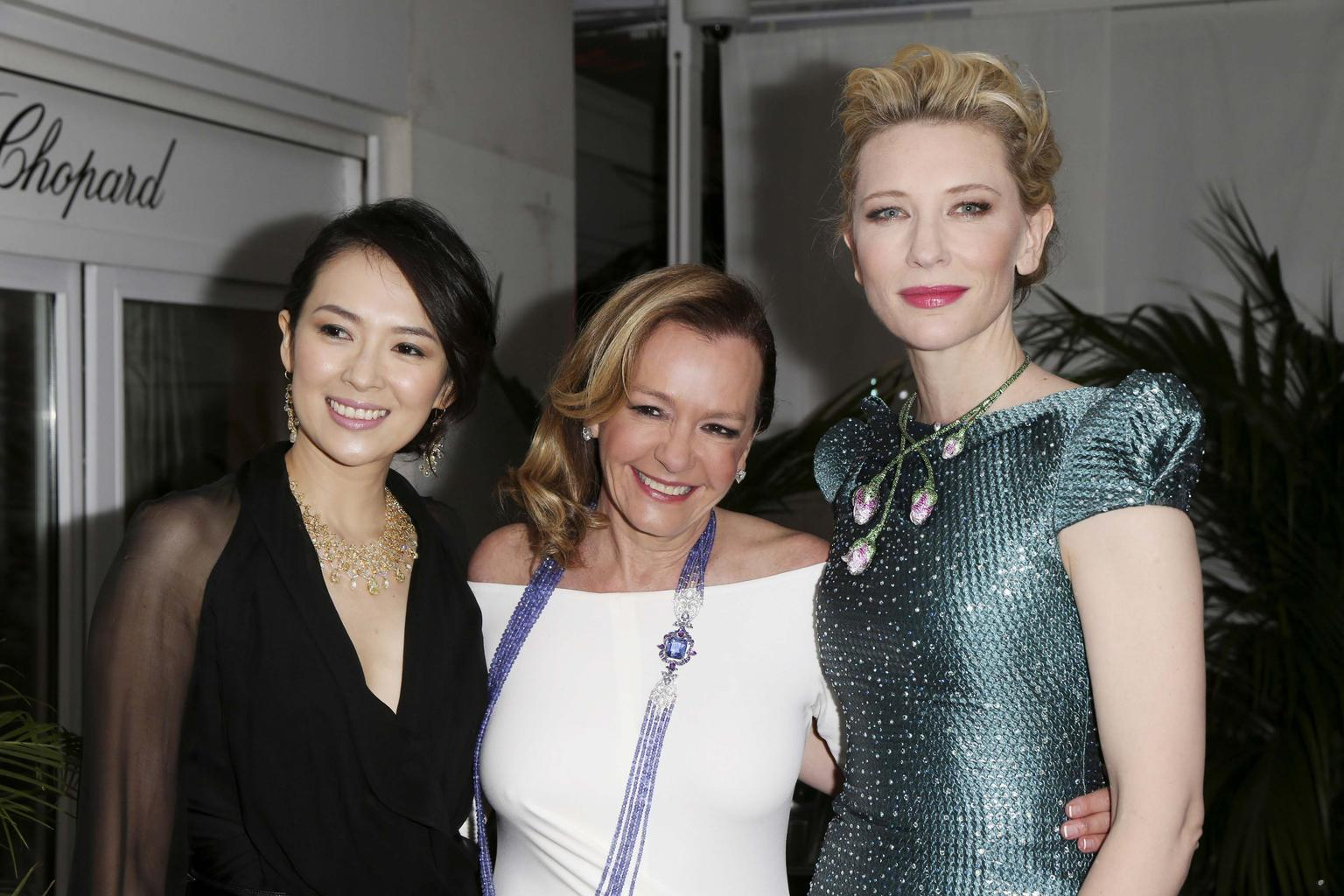 After a quick change of clothes, Cate Blanchett, pictured beside Caroline Scheufele, centre, and Zhang Ziyi, arrived at the Trophée Chopard 2014 party in a dress worthy of any red carpet, paired with a tsavorite, pink sapphire and ruby floral necklace fro