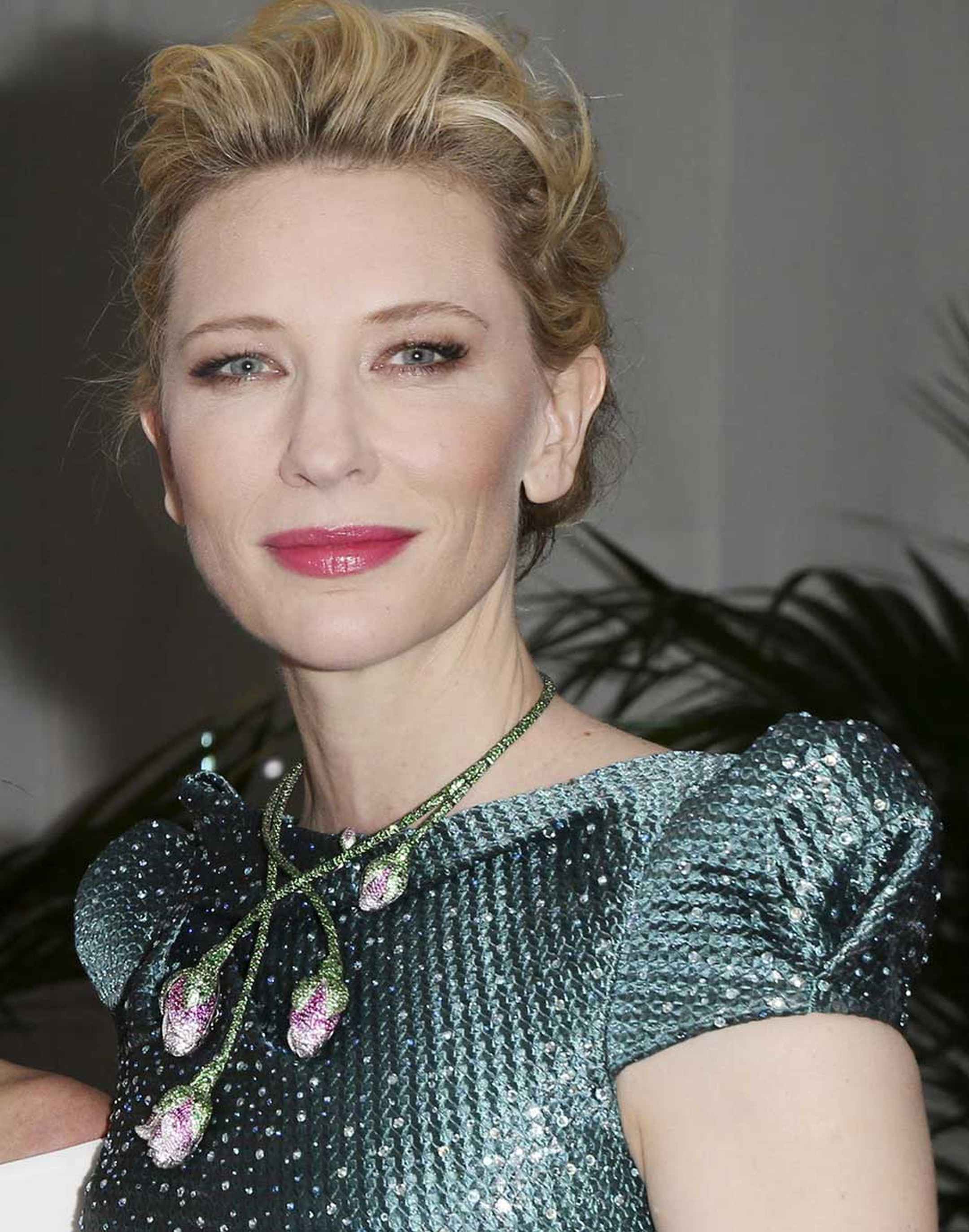Cate Blanchett arrived at the Trophée Chopard 2014 afterparty in a dress worthy of any red carpet, paired with a tsavorite, pink sapphire and ruby floral necklace from Chopard's Red Carpet collection.