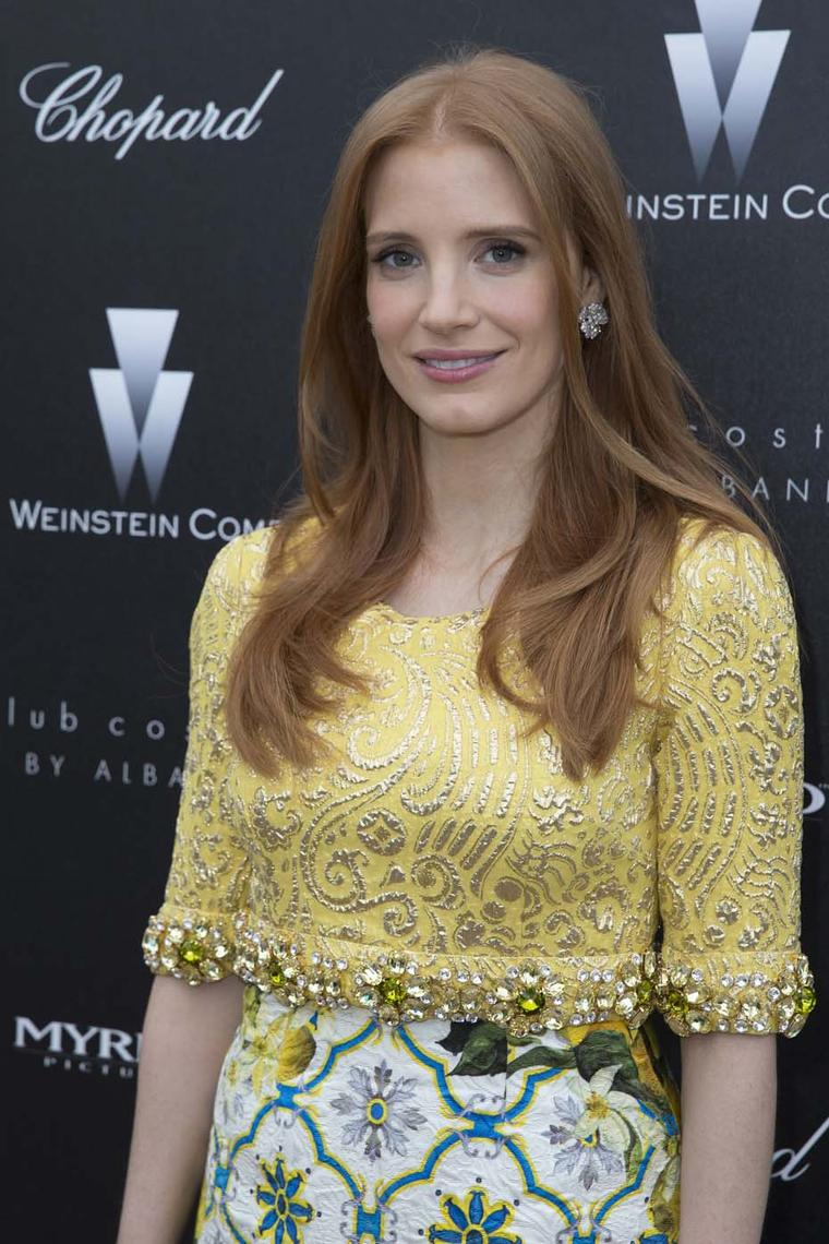Jessica Chastain at the Weinstein party wearings Chopard diamond earrings.